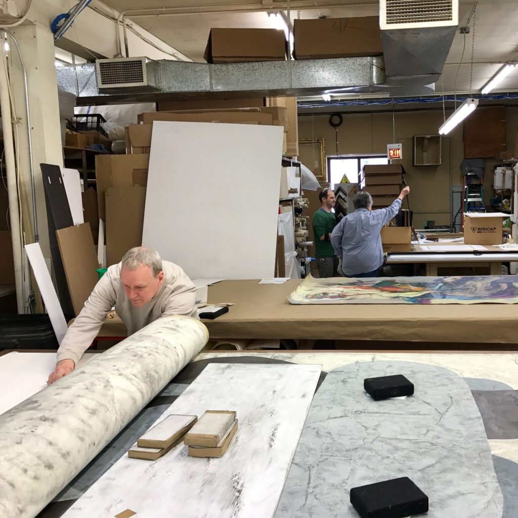Canvases being stretched