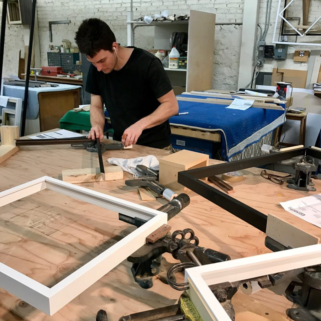 joiner glues and sets the corners on several frames